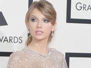 Taylor Swift steals the show on the Grammy Awards red carpet