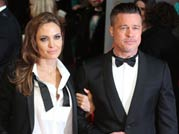 Brad Pitt, Angelina Jolie show up in matching tuxedos at BAFTAs 2014