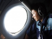 Search resumes for debris of missing MH 370