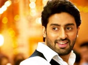 Abhishek Bachchan shoots hoops at a promotional event