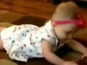Viral video: A dog teaches a baby how to crawl