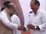BJP covers up DP Yadav's presence on stage with Amit Shah