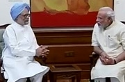 After attack, Modi calls on Manmohan to discuss economics