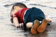 Photo of drowned Syrian boy show tragic plight of refugees