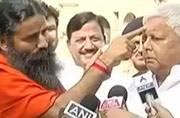 Watch: Lalu endorses Patanjali products, Ramdev applies cream on Lalu's face