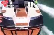 Man wave-skates behind driverless boat