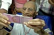 PM Modi's mother queues up at bank for currency exchange