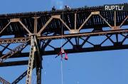 Guatemalan Firefighter Abseils Down Bridge to Give GIfts to Poor Children