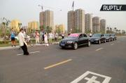 Balls of Steel! Tai Chi Master Pulls Four Cars with Bare Testicles
