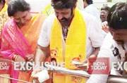 Balakrishna caught on camera distributing money during road show