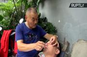 Keep Your Eyes Peeled! This Barber Will Clean Your Eyes with Knives