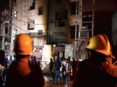 Firemen outside the two-storey cracker factory in Bawana Industrial Area where a fire broke out.