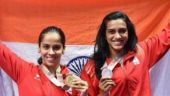 Saina Nehwal, PV Sindhu return home to heroes' welcome