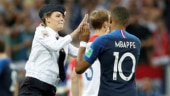 Kylian Mbappe gave a high-five to one of the streakers who invaded the pitch during the World Cup final