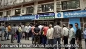 People standing outside SBI ATM