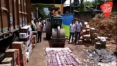 6 lakh illegal liquor bottles worth Rs 168 crore destroyed by road roller in Assam