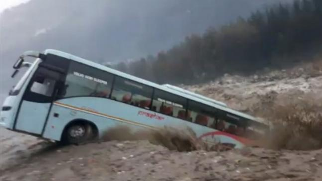 Watch: Bus washed away by overflowing river in Manali