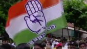 Congress workers with party flag.