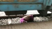 Woman tries to cross railway track in Karnataka, gets stuck under moving train