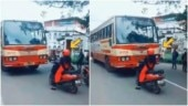 Kerala woman stops scooty in front of bus driving in wrong lane