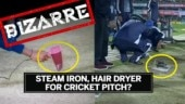 Hair dryer, steam iron used on a wet cricket pitch|Bizarre