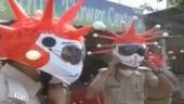 Image of the Day: Walk-in Simple Kiosk in Kerala, 9pm-9minute disco dancer, virus-themed helmets in Gujarat