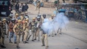 Migrants resort to violence in Surat, police fire tear gas
