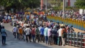 Thousands of migrants gather in Mumbai's Bandra