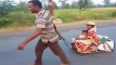 Image of the day: Man pulls cart for 650-km with pregnant wife and son on it to reach home
