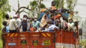 Watch: How migrant workers are shelling out thousands to buy spots in trucks to reach their homes