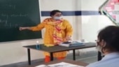 Images of the day: Senior students return to schools; Assam doctor's dance goes viral