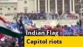 Row erupts over Indian flag seen at US Capitol attack; Call for Donald Trump impeachment grows; more