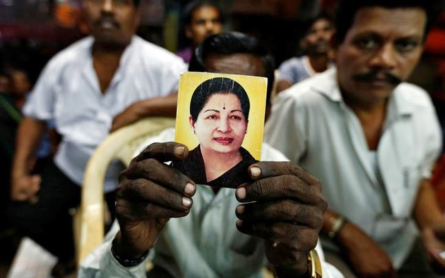 A supporter holds up a photo of former Tamil Nadu Chief Minister Jayalalithaa, whose death left the RK Nagar seat vacant (File photo: Reuters)