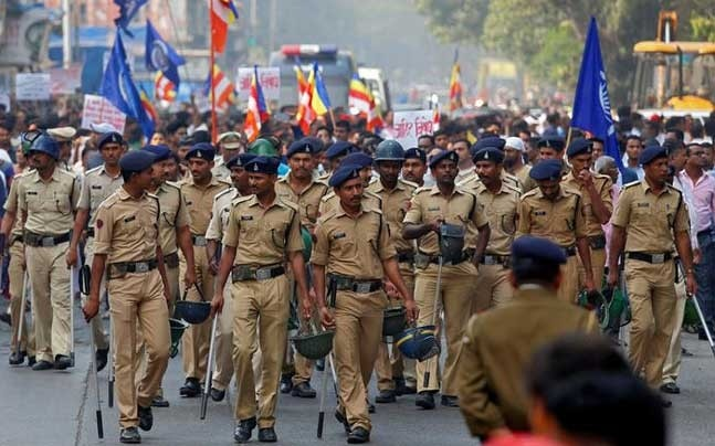 Police patrol a street as members of the Dalit community hold a protest in Mumbai (Photo: Reuters)