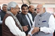 Bihar CM Nitish Kumar and PM Narendra Modi at Vijay Rupani's swearing-in ceremony.