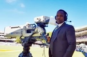 India in South Africa: Why does this cameraman come to work dressed in a suit?