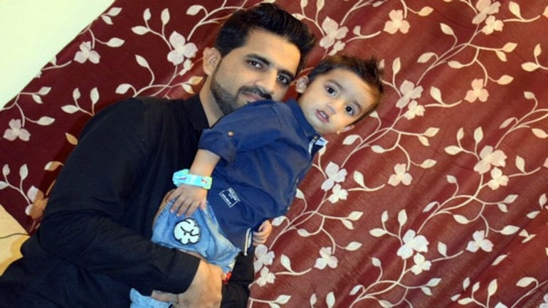 Touqeer Ali with his son