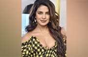Priyanka Chopra is making a baggy chequered dress look sexy
