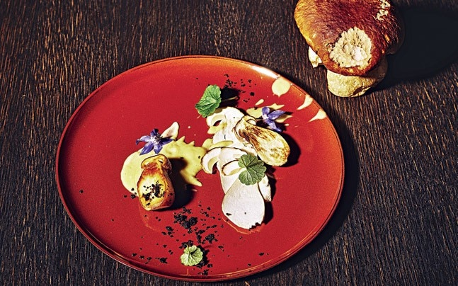 EARTHY PLEASURES Porcini, porcini cream and Braumannswiesen borretsch flowers.Photo: Simon Bolz