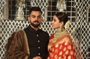 Virat Kohli and Anushka Sharma posing for pictures for the media ahead of their reception.