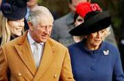 Britain's Prince Charles and his wife Camilla lead members of the royal family as they arrive to attend the Christmas Day church service in Sandringham, Britain.