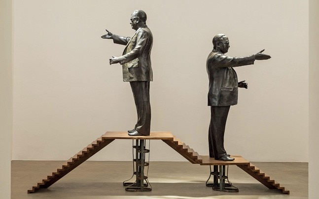 HOLY SHIVER (Left) Riyas Komu's Fourth World is a work in wood and bronze