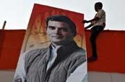In this file photo from 2014, a boy hold a poster of then Congress vice-president Rahul Gandhi (Photo: Reuters)
