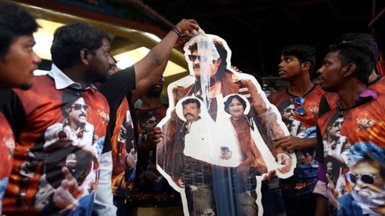 Supporters pour milk over a cut-out of Rajinikanth, who announced his political entry today (File photo: Reuters)