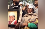 Santosh Koli's mother with her supporters