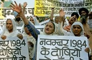 Sikhs shout slogans while carrying placards during a protest rally in New Delhi, November 5, 2004. REUTERS/B Mathur AH/CN