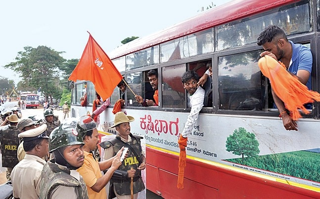 Police stop BJP workers going to a Hanuman Jayanti rally, December 3.