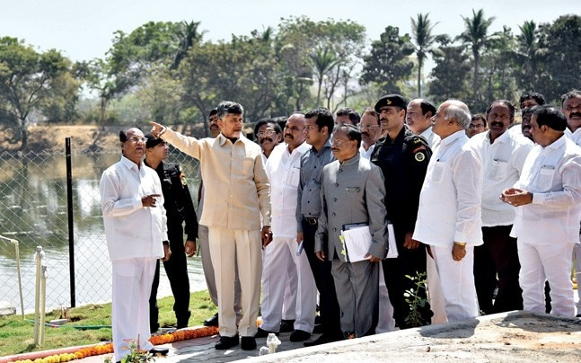 WALK THE TALK? CM Naidu with officials at a new eco-tourism park in Guntur