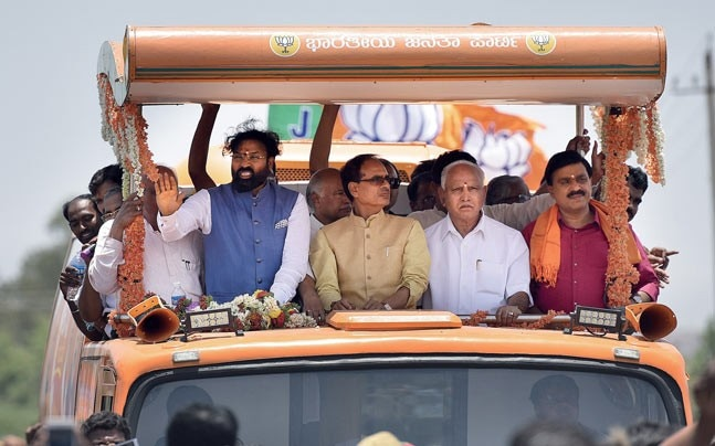 BACK IN BUSINESS (From left) Sriramulu with Madhya Pradesh CM Shivraj Chouhan, Yeddyurappa and Janardhana Reddy at a BJP roadshow in Chitradurga. Photo: Getty Images
