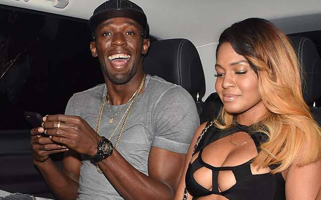 Usain Bolt with the mystery woman in London. (PALACE LEE/REX/SHUTTERSTOCK Photo)